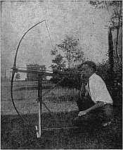 The author with a shooting machine which he designed for use in testing arrows.